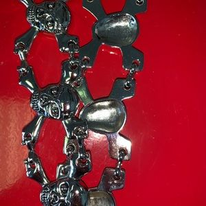 Skull and crossbones and leather belt